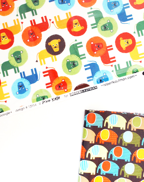 lions and elephants slicker fabric / ann kelle